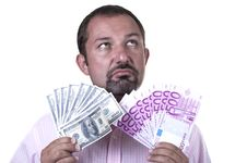 Free Man Torn Between Dollars And Euros Stock Photo - 20820790
