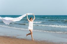 Woman Is Running On The Beach With White Shawl Royalty Free Stock Images