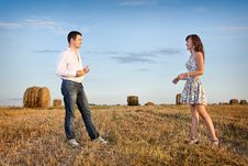 Married Couple In The Field Nearby Stock Photo
