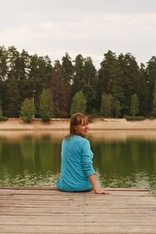 Free Young Woman Sitting On Jetty Royalty Free Stock Image - 20824196