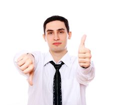 Businessman Holding One Thumb Up And Another Down Royalty Free Stock Image