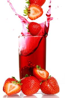 Strawberry Falling Into The Glass Stock Image