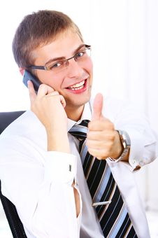 Businessman Shows OK Sign While Calling By Phone Royalty Free Stock Photos