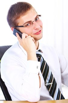 Free Young Smiling Businessman Using Cell Phone Royalty Free Stock Photography - 20826387