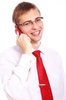Free Young Smiling Businessman Using Cell Phone Stock Photo - 20826400