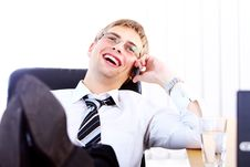 Free Young Smiling Businessman Using Cell Phone Stock Photography - 20826432