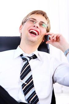 Free Young Smiling Businessman Using Cell Phone Stock Images - 20826434