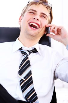 Young Smiling Businessman Using Cell Phone Royalty Free Stock Photo