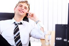 Free Young Smiling Businessman Using Cell Phone Royalty Free Stock Photos - 20826448