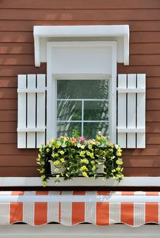 Decorated Window In Brown Wall Stock Photography