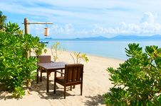 Chairs And Table On Beach Near The Sea Royalty Free Stock Photos