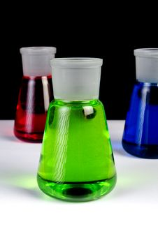 Free Chemicals In Laboratory Glassware On Black Royalty Free Stock Photography - 20829787