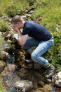 Free Young Man Taking A Refreshment In The Mountains Royalty Free Stock Photo - 20835075