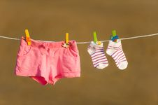Free Shorts And Socks Are Drying On A Line With Stock Images - 20830154