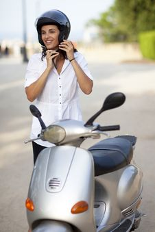 Free Woman Takes Off Her Helmet Royalty Free Stock Photo - 20831675