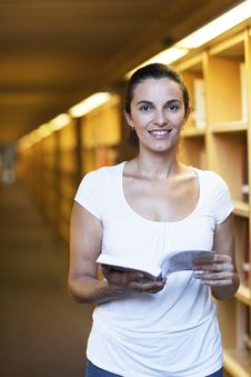 Free Woman In The Library Stock Photo - 20831840