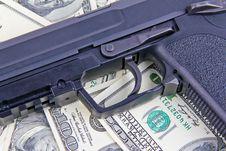 Free Handgun On Dollar Notes Stock Photography - 20832232