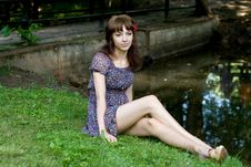 Free Beautiful Girl Sitting On Bank Of A River Stock Photos - 20832363