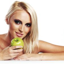 Girl With An Apple Royalty Free Stock Photography