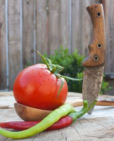 Free Wooden Spoon Tomato Hot Pepper And Small Knife Stock Images - 20833604
