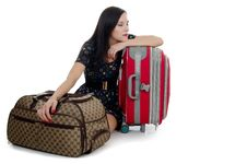 The Tired Girl With Suitcases Royalty Free Stock Images