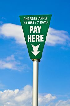 Green Pay Here Sign Stock Photos