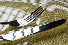 Fork And Knife On A Plate Royalty Free Stock Images