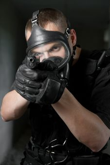 Free Soldier In Gas Mask Targeting With 9mm Pistol Stock Photography - 20841522