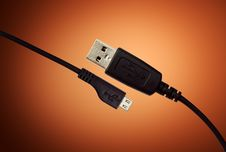 Free USB Cable On Orange Background Royalty Free Stock Image - 20841726