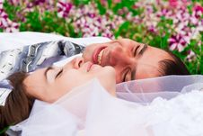 Free Happy Bride And Groom Lying On A Green Grass Royalty Free Stock Photography - 20843677