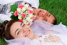Free Happy Bride And Groom Lying On A Green Grass Stock Images - 20843894