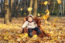Free Little Boy Sitting In Chair Outdoors Stock Photo - 20848110