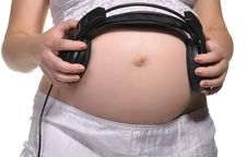 Free Pregnant Woman With Headphones Stock Photography - 20848112