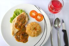 Chicken Steak With Fried Rice And Pink Wine Stock Image