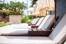 Plank Beds With Umbrellas In A Sunny Day Stock Photo