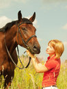 Free Kissing  Of Young  Girl With Your  Horse In Field Stock Photo - 20857210