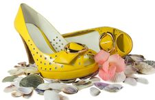Free Pair Of Yellow Shoes And Seashells Isolated Stock Photos - 20850553