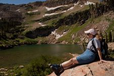Resting Hiker @ An Alpine Lake Royalty Free Stock Images