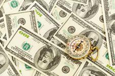 Compass On Money Background Stock Photo