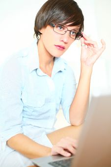 Free Beautiful Girl With Glasses Working On Laptop Royalty Free Stock Photos - 20853418
