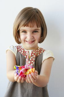 Free Little Girl Holding Candies Royalty Free Stock Photo - 20853475