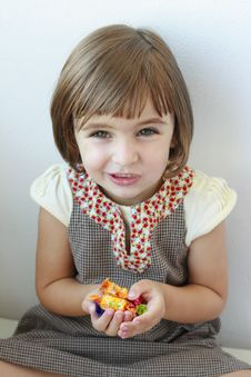 Free Little Girl With Candies In Her Hands Stock Photography - 20853512