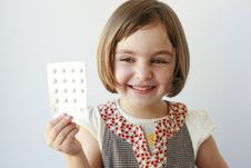 Free Little Girl With Medicaments In Her Hand Stock Photo - 20853570