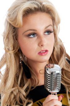 Pretty Young Female With Microphone Royalty Free Stock Photos
