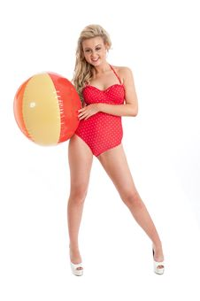Pretty Young Female In Red Swimsuit And Inflatable Stock Image