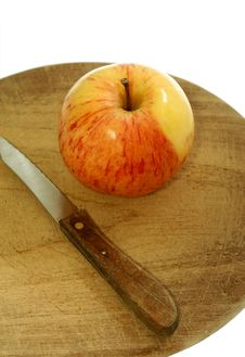 Apple And Knife On Kitchen Board Isolated On White Stock Photo