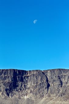 Moon On A Background Of Blue Sky And Mountains Royalty Free Stock Image