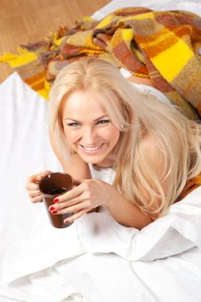 Beautiful Blonde Is Drinking Coffee In Bed Stock Photos