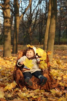 Free Little Boy In A Chair Outdoors Stock Image - 20855561