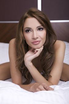 Beautiful Brunette In Bed Royalty Free Stock Photography